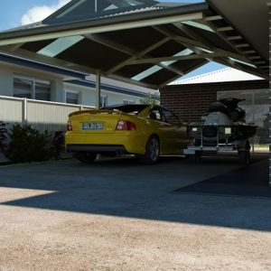 Photo Of A Carport With A Yellow Car Under